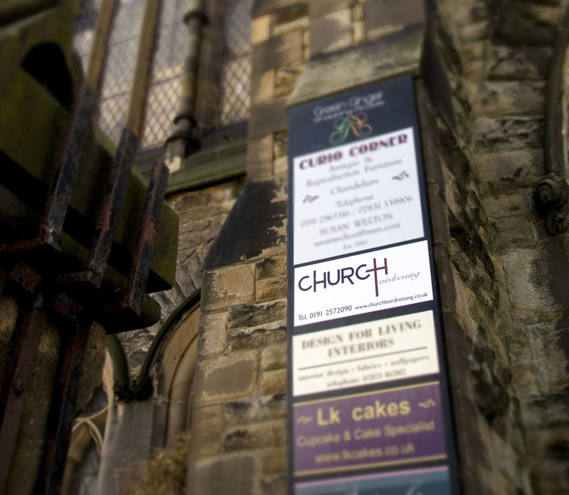 A shot of outside the Church showing the sign for church hair stylists in Tynemouth